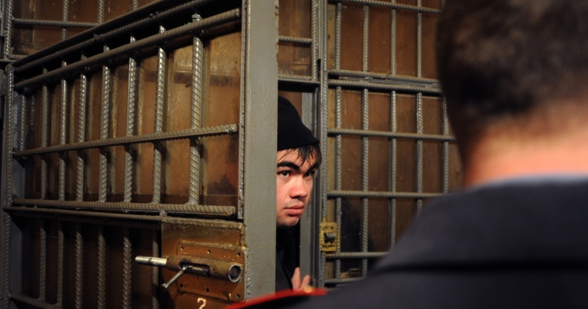 A police officer locks up a detained illegal migrant from Uzbekistan in Moscow earlier this year. Putin plans to toughen immigration legislation in a proposal analysts said would also restrict domestic travel, and openly flirted with xenophobia.</p>