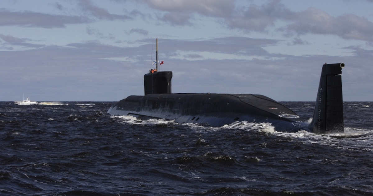 A new Russian nuclear submarine, the Yuri Dolgoruky, drives in the water area of the Sevmash factory in the northern city of Arkhangelsk on July 2, 2009.</p>