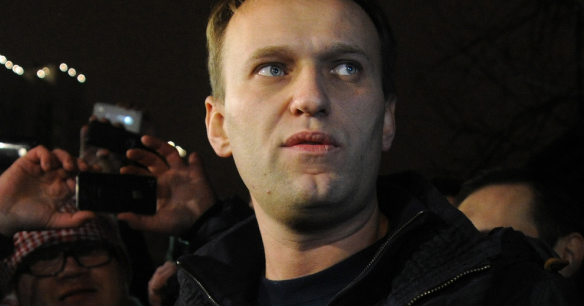 Anti-Kremlin blogger Alexei Navalny speaks to journalists and supporters outside a police station in Moscow, early on December 21, 2011.</p>