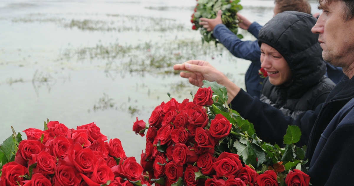 People lay flowers at the site of a plane crash that killed the Lokomotiv Yaroslavl hockey team in 2011. The team was traveling to their first match of the KHL (Kontinental Hockey League) season when their plane crashed on takeoff.</p>