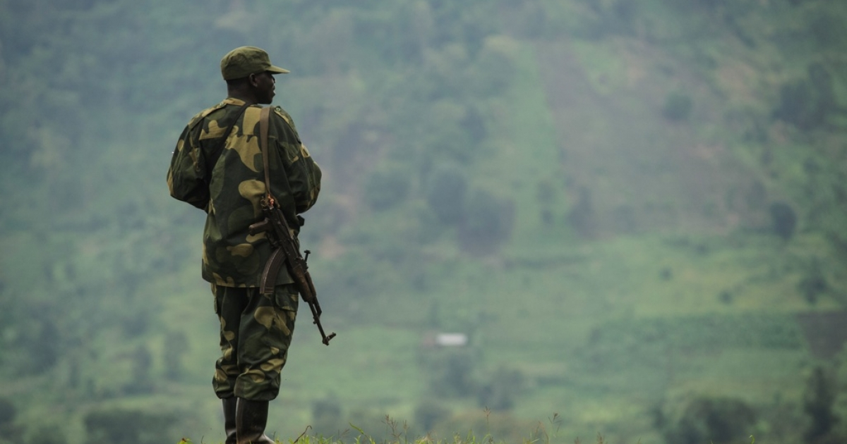 A soldier from the Armed Forces of the Democratic Republic of the Congo (FARDC) on the lookout for M23 rebels at an army outpost between the village of Kachiru and Mbuzi hill — an M23 rebel position — in North Kivu, eastern Congo on May 24, 2012. A UN report charges that Rwanda has supported the M23 rebels, but the Rwandan government denies the allegation.</p>