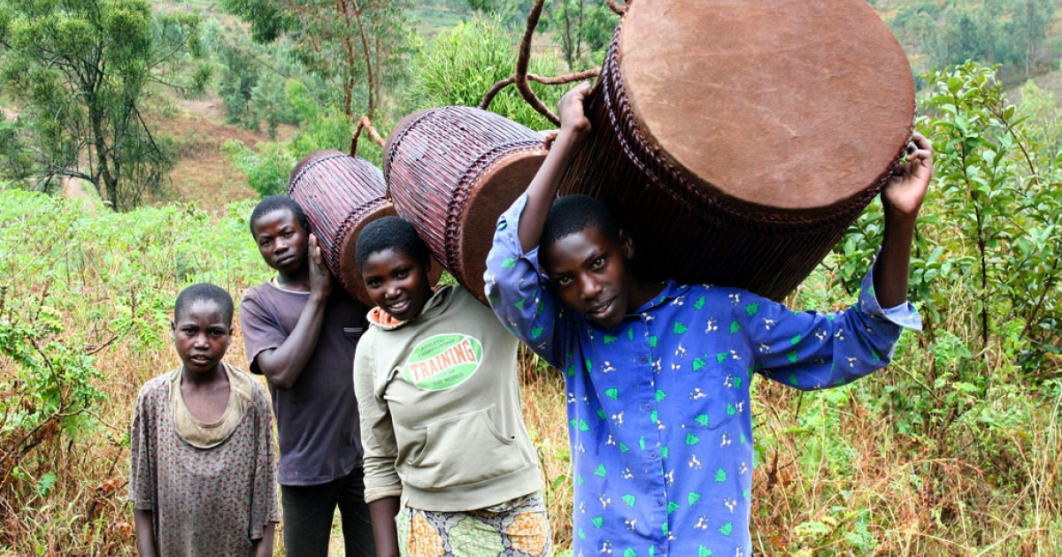 Following centuries of tradition, Denis Kagaba has crafted handmade drums from his rural home in Rwanda. At 15, his son Jean-Paul (right) is a keen apprentice.</p>