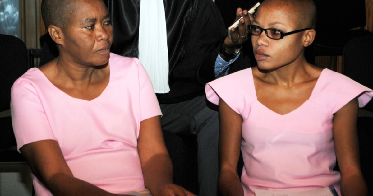 Rwandan journalists, Agnes Uwimana Nkusi (R) and Saidati Mukakibibi (L), sit on Jan. 30, 2012 in Rwandan's Supreme Court for the first day of their appeal in Kigali. Both were given in prison sentences of 17 and seven years respectively following convictions on charges of genocide denial, inciting civil disobedience and defamation.</p>