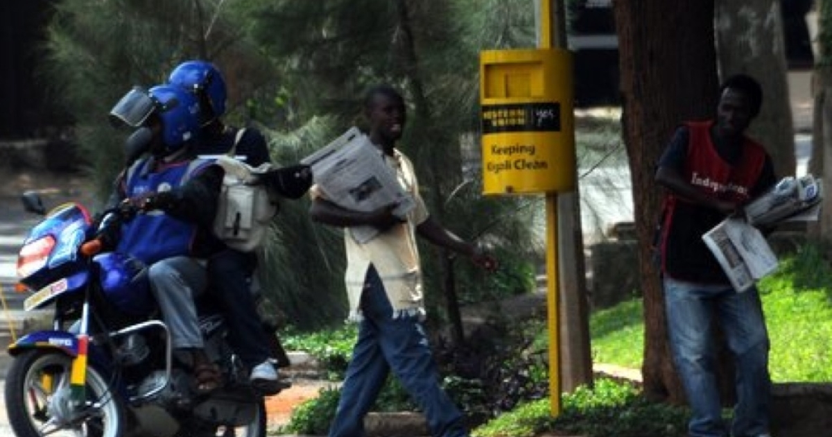 Rwandan news hawkers sell paper in downton Kigali on December 18, 2011.</p>