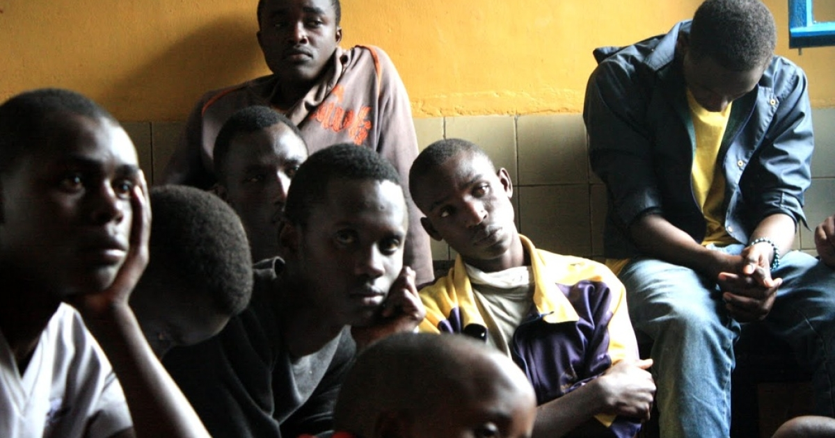 Orphans listen as officials explain the Noel Nyundo will relocate them to families in nearby communities.</p>