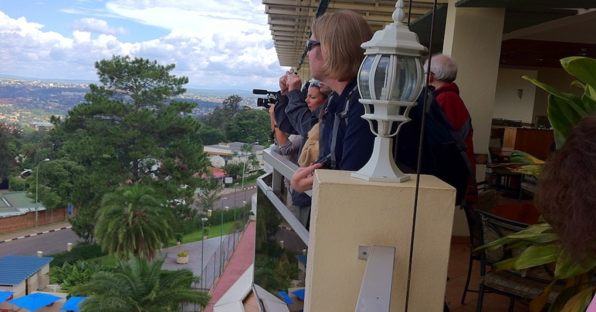 """Members of the International Reporting Project's two-week tour of Rwanda take in the view from the top terrace of the Mille Collines Hotel, popularly known as """"Hotel Rwanda.""""</p>"""