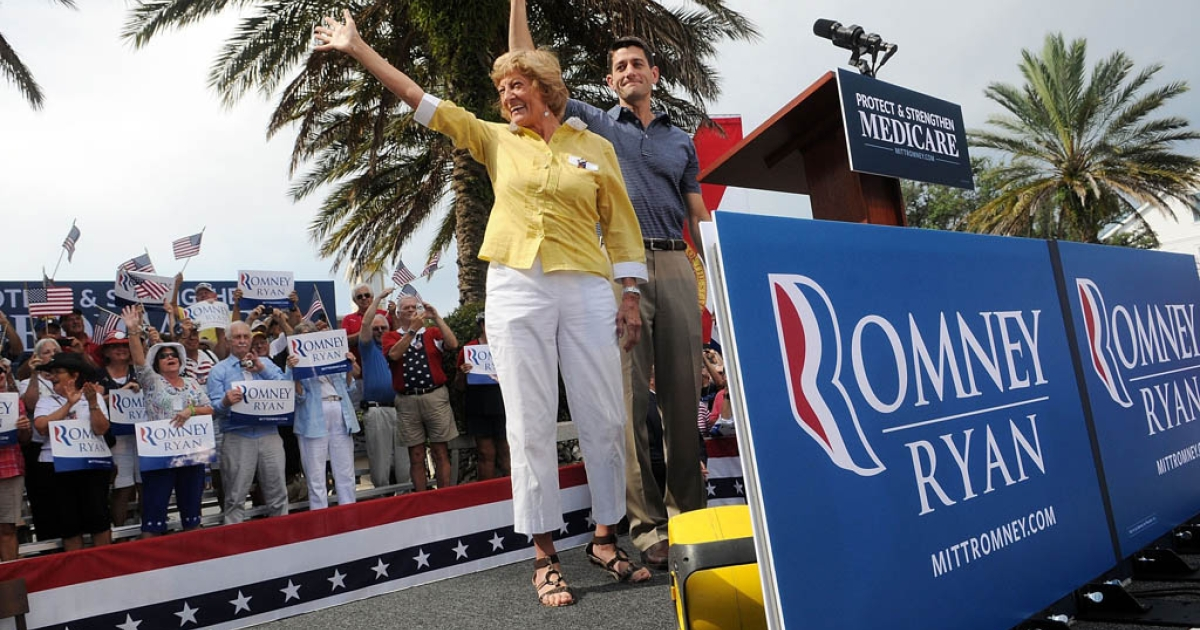 THE VILLAGES, FL - AUGUST 18:  Republican Vice Presidential candidate, U.S. Rep. Paul Ryan (R-WI) (R) and his mother Elizabeth Ryan wave during the Victory Rally in Florida at Town Square, Lake Sumter Landing on August 18, 2012 in The Villages, Florida. Ryan spoke about his family's reliance on Medicare.</p>