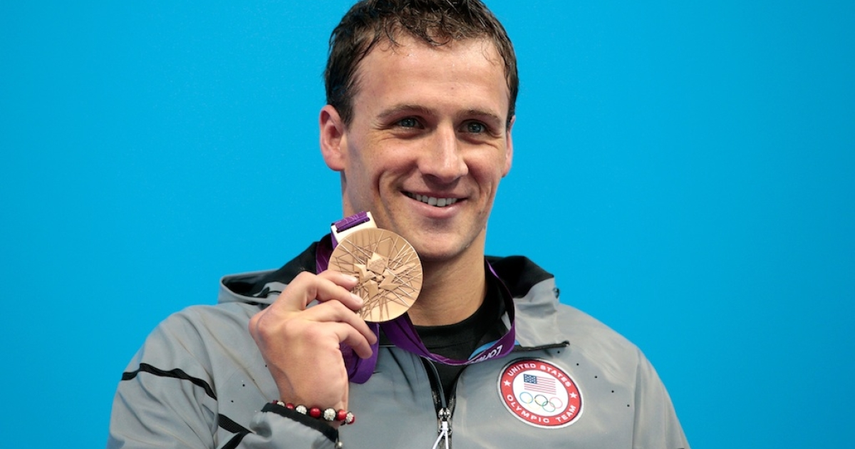 Silver medallist Ryan Lochte poses on the podium during the medal ceremony for the Men's 200m Individual Medley on August 2, 2012, after losing to Michael Phelps (again).</p>