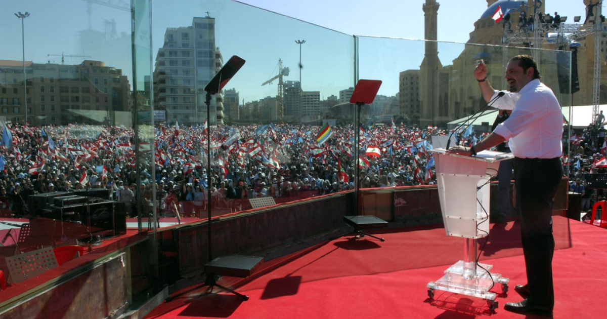 Outgoing Lebanese prime minister Saad Hariri delivers a speech as part of a mass rally gathering ten of thousands Lebanese opposition supporters to demand Hezbollah to be disarmed. Absent from Lebanon since April, Hariri has recently turned to Twitter to stay in touch with supporters.</p>