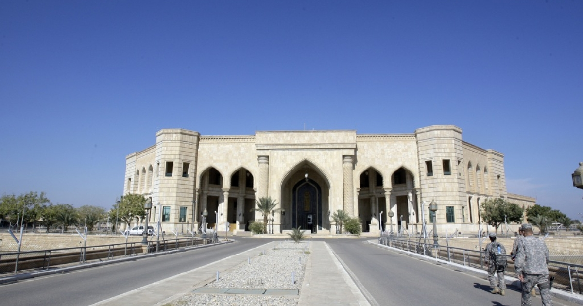 US soldiers walk towards the Al-Faw palace on November 7, 2011, formerly owned by executed Iraqi leader Saddam Hussein and located in what is now the US military Camp Victory complex in Baghdad. What were once among the most sensitive US sites in Iraq, including a palace that housed top generals and a bombed-out villa that held Saddam Hussein, will soon be back in Iraqi hands by the end of the year.</p>