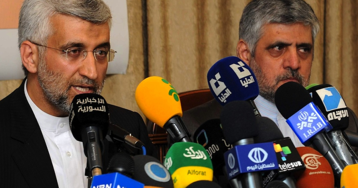 Saeed Jalili, head of Iran's supreme national defence council, holds a joint press conference with Iranian ambassador to Syria Mohammad Reza Sheibani (R) at the Iranian embassy in the Syrian capital Damascus on August 7, 2012. Tehran will continue to back Syria under President Bashar al-Assad, which acts as a pillar of an Iranian-led regional alliance, Jalili told Assad in Damascus.</p>
