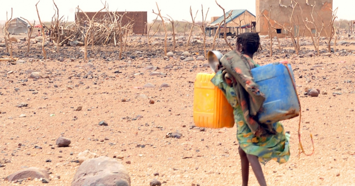 A girl carries cans to fill with water in southeastern Mauritania, on May 4, 2012. The food crisis across West Africa's Sahel region puts millions at risk of hunger, according to the UN.</p>