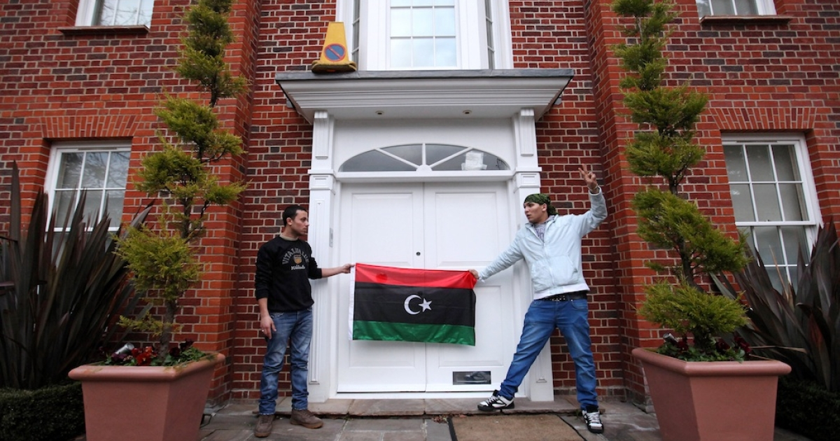 Squatters demonstrate outside the London home of Saif Gaddafi, the son of Libyan leader Muammar Gaddafi, on March 9, 2011, in London, England.</p>