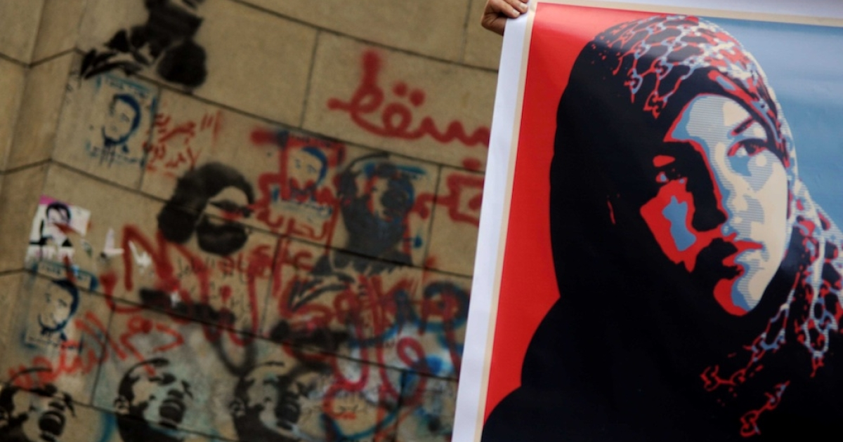 An Egyptian protestor holds a picture of Samira Ibrahim, an Egyptian woman who brought the case against an army doctor, Ahmed Adel, accused of conducting forced 'virginity tests' on female protestors, during a demonstration in solidarity with Ibrahim in Cairo on March 16, 2012.</p>
