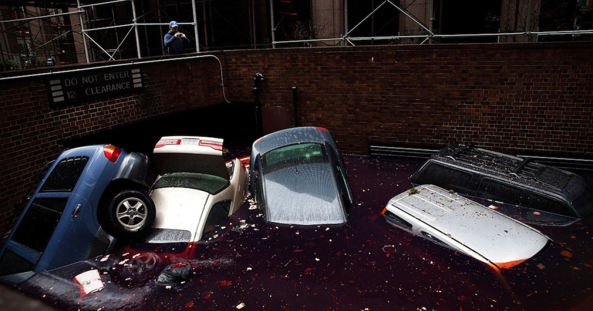 Cars floating in a flooded basement in the financial district of New York City following Hurricane Sandy on October 30, 2012.</p>