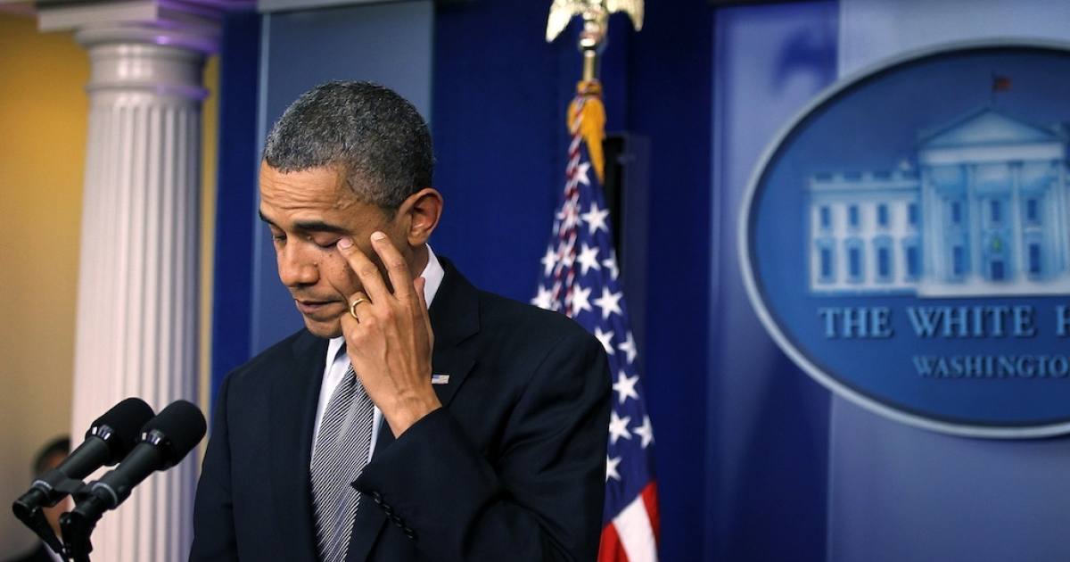 President Barack Obama wipes tears as he makes a statement in response to the elementary school shooting in Connecticut December 14, 2012 at the White House in Washington, DC. According to reports, there are 27 dead, including the shooter, 20 of them children, after Ryan Lanza, 24, opened fire in at the Sandy Hook Elementary School in Newtown, Connecticut. Reports say that Lanza was dead at the scene and his mother, a teacher at the school, is also dead. His brother has also been found dead in Hoboken, New Jersey.</p>