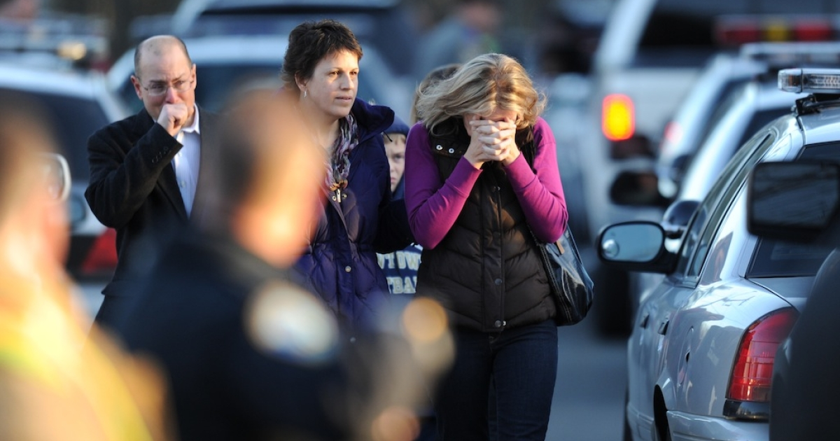 Residents grieve following a shooting December 14, 2012 at Sandy Hook Elementary School on December 14, 2012 in Newtown, Connecticut.</p>