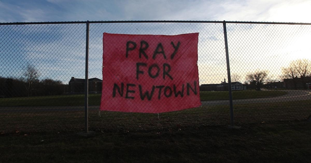 A handwritten sign reads 'Pray for Newtown' following the mass shooting at Sandy Hook Elementary School December 15, 2012 in Newtown, Connecticut.</p>