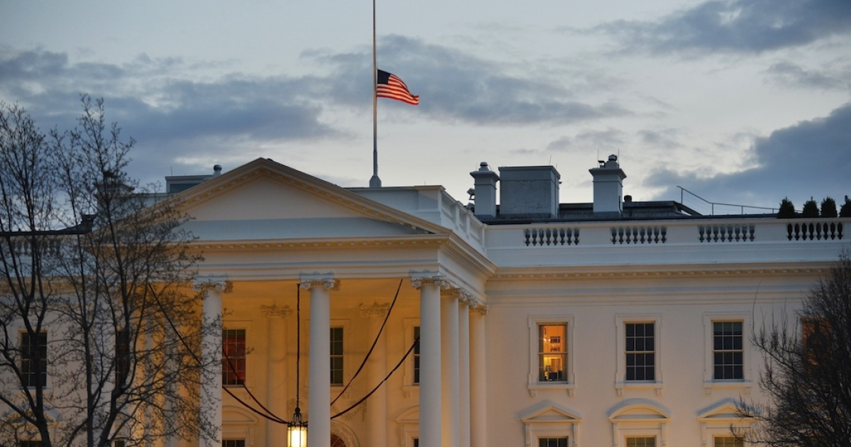 A US flag flies at half-staff above the White House on December 15, 2012 in Washington, DC.</p>