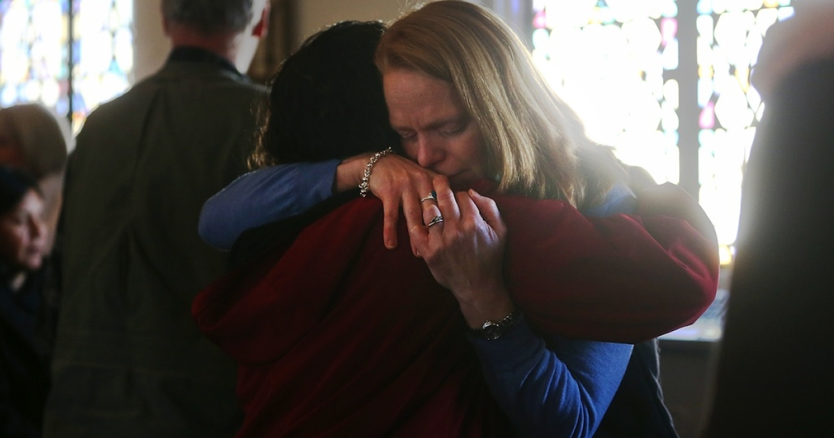 People embrace at a prayer service to reflect on the violence at Sandy Hook Elementary School at St. John Episcopal Church on December 15, 2012 in Newtown, Connecticut.</p>