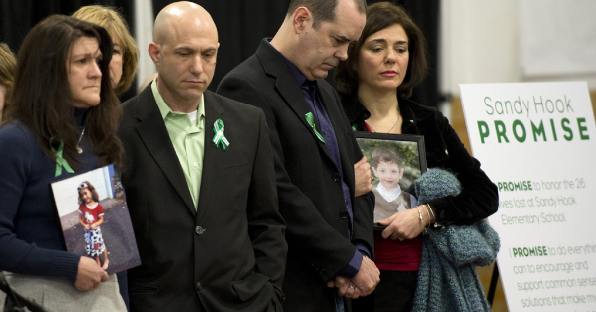 Family members of victims of the Sandy Hook Elementary School shooting attend a news conference on January 14, 2013 in Newtown, Connecticut. Families of victims asked that there be a dialogue to find solutions on how to prevent similar future violence.</p>