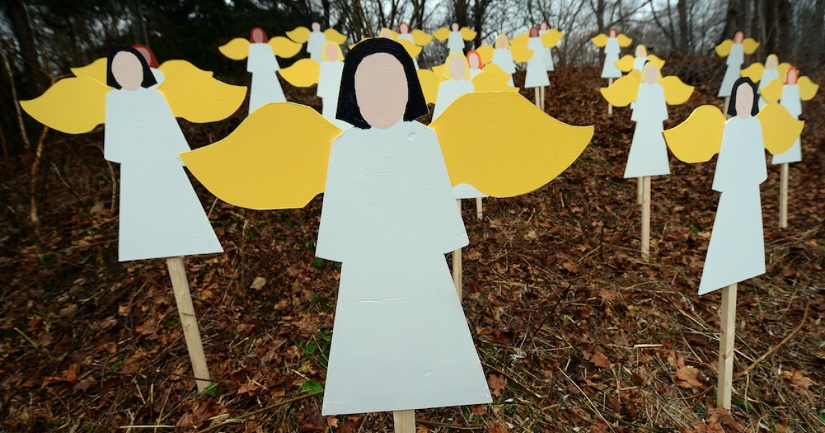 Twenty seven angel wood cut-outs are set up on hillside in memory to the victims of an elementary school shooting in Newtown, Connecticut, December 16, 2012.</p>
