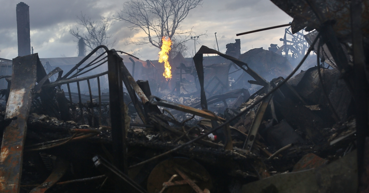 Homes and businesses burned down in the Rockaway, Queens during superstorm Sandy. Can New York City and other areas hit hard by the storm recover in time for the Nov. 6 election?</p>