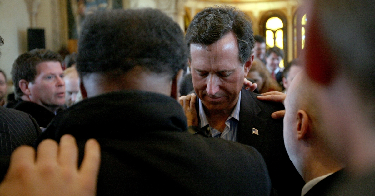 Supporters pray over Republican presidential candidate Rick Santorum during a campaign stop at the Bella Donna Chapel in McKinney, Texas, on Feb. 8, 2012.</p>