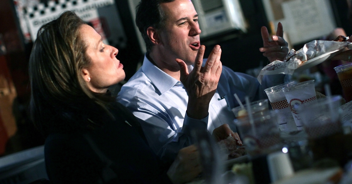 Rick Santorum eats ribs at Dreamland Bar-B-Que with his wife Karen during a campaign stop yesterday in Tuscaloosa, Alabama.</p>