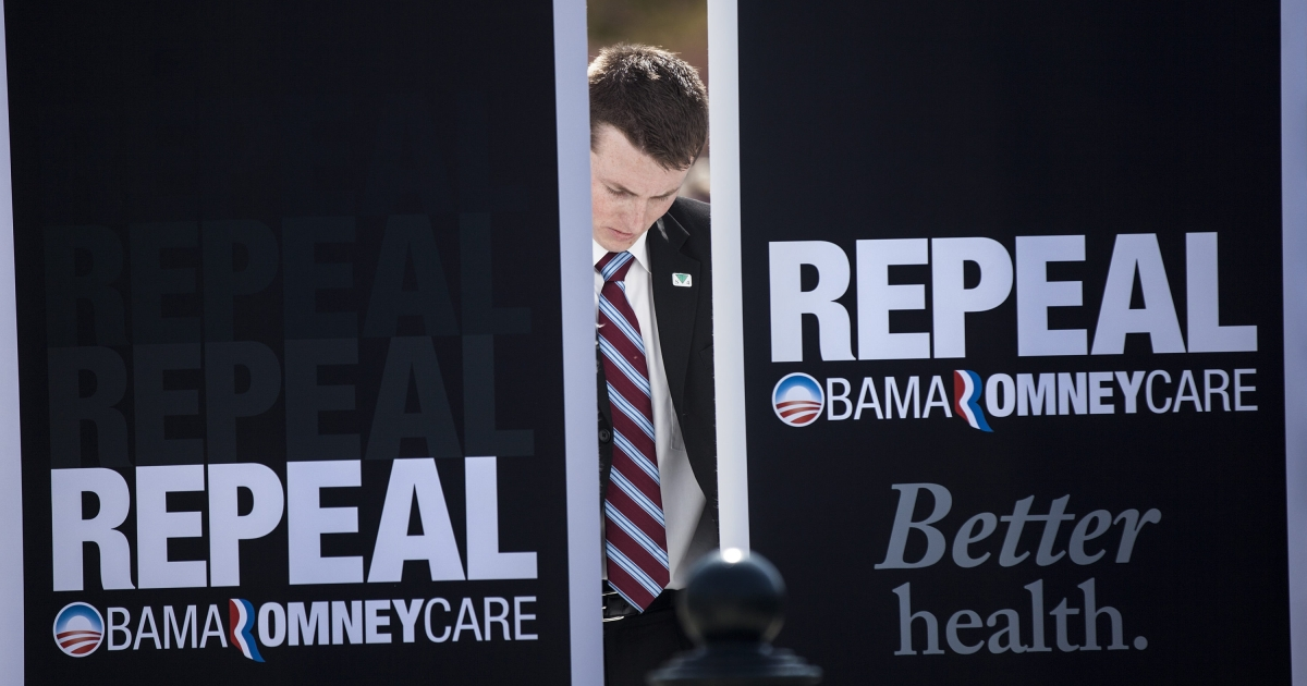 A member of Rick Santorum's staff sets up a backdrop outside the US Supreme Court today in Washington.</p>