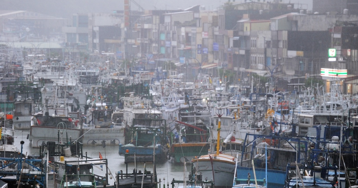 Fishing boats are moored in a shelter at the Nanfangao harbor in eastern Ilan county, as typhoon Saola approches the island's east coast on August 2, 2012. Typhoon Saola reached Taiwan, causing nearly the entire island to close down and bringing torrential rains that could linger until next week, officials said.</p>