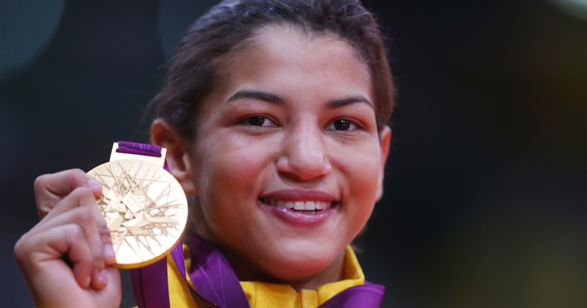 Sarah Menezes of Brazil celebrates winning the gold medal in the women's 48kg judo category at the London 2012 Olympic Games on July 28, 2012 in London, England.</p>