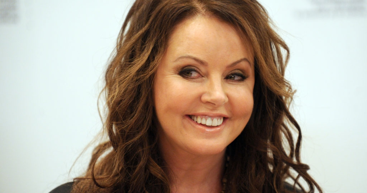 Famed British singer Sarah Brightman smiles during her press conference in Moscow on October 10, 2012.  Brightman announced today in Moscow that she will blast off next year as a space tourist to the International Space Station.</p>