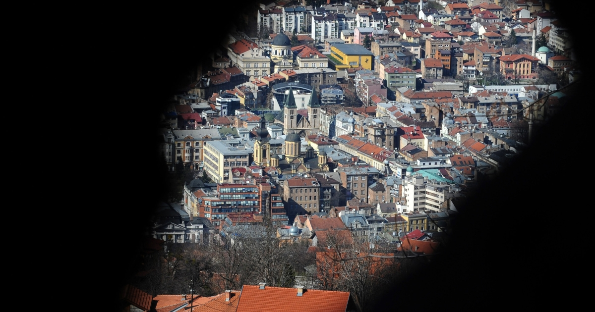 A former sniper position on slopes of mount Trebevic gives a view of Bosnian capital Sarajevo, on April 2, 2012.</p>