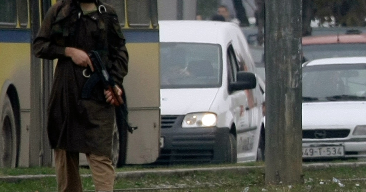 Mevlid Jasarevic (23), stands at an intersection holding an AK-47, after allegedly opening fire on the U.S. Embassy in Sarajevo, on October 28, 2011.</p>