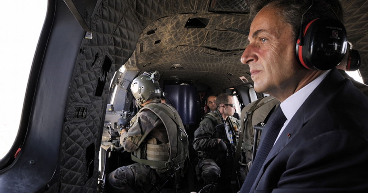 France's President Nicolas Sarkozy aboard a helicopter in Kabul, Afghanistan, on July 12, 2011, during a surprise visit to meet troops stationed in Sarobi district.</p>
