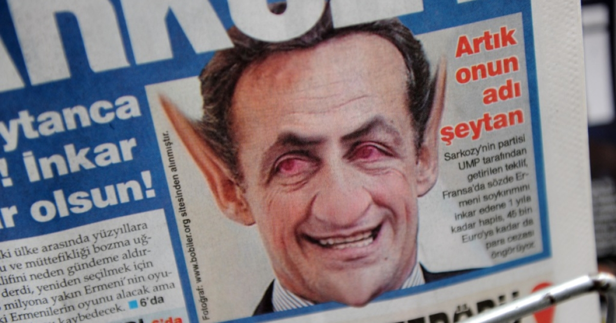 A photo taken on Jan. 24, 2012 shows a manipulated picture of France's President Nicolas Sarkozy with giant ears and red eyes reading 'Now his name is Satan' on the front page of a newspaper in Istanbul.</p>
