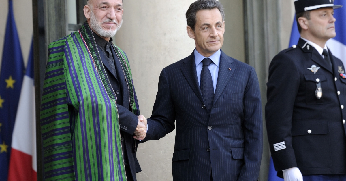 French President Nicolas Sarkozy welcomes his Afghan counterpart Hamid Karzai at the Élysée Palace on January 27, 2012 in Paris.</p>