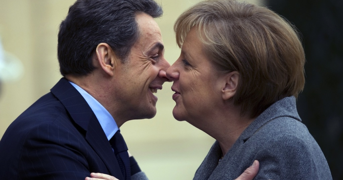 French President Nicolas Sarkozy (L) kisses German Chancellor Angela Merkel upon her arrival for a joint Franco-German cabinet session at the Elysee Palace on Feb. 6, 2012 in Paris.</p>