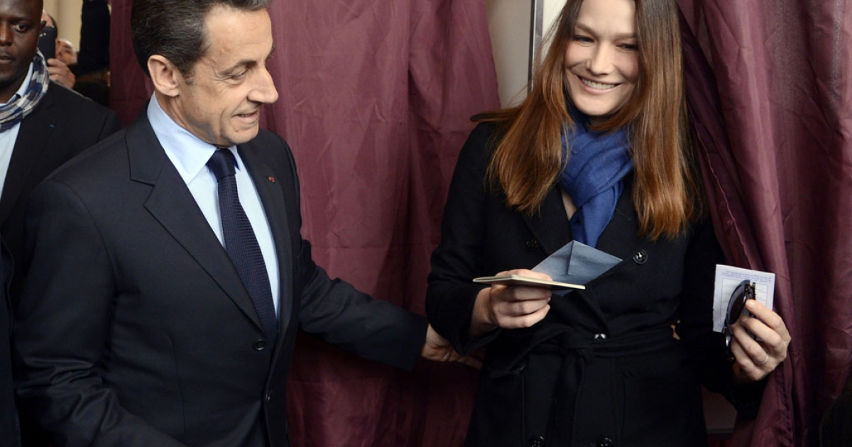 President Nicolas Sarkozy and his wife, Carla Bruni-Sarkozy, vote in presidential elections today in Paris. Sarkozy is attempting to win his second five-year term.</p>