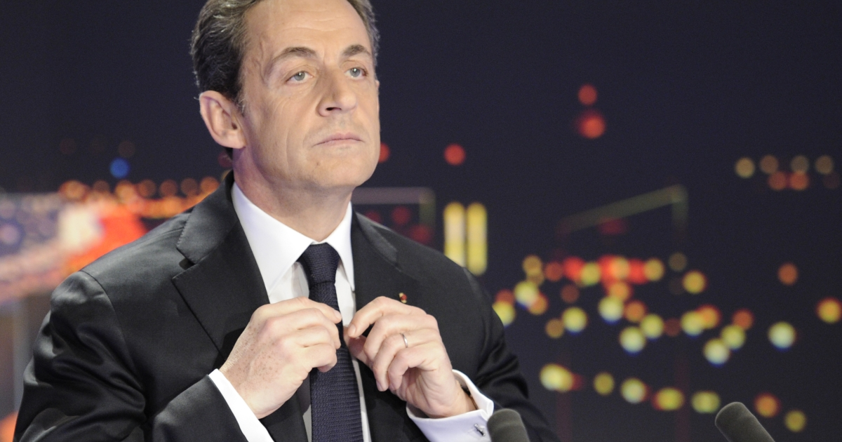 French President Nicolas Sarkozy poses today prior to taking part in a TV newscast outside Paris.</p>