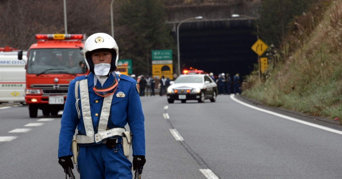 A policeman stands guard in front of the entrance of the collapsed Sasago tunnel on the Chuo expressway in Koshu city, Yamanashi prefecture, on Dec. 2, 2012. Nine people were killed in the collapse and subsequent fire.</p>