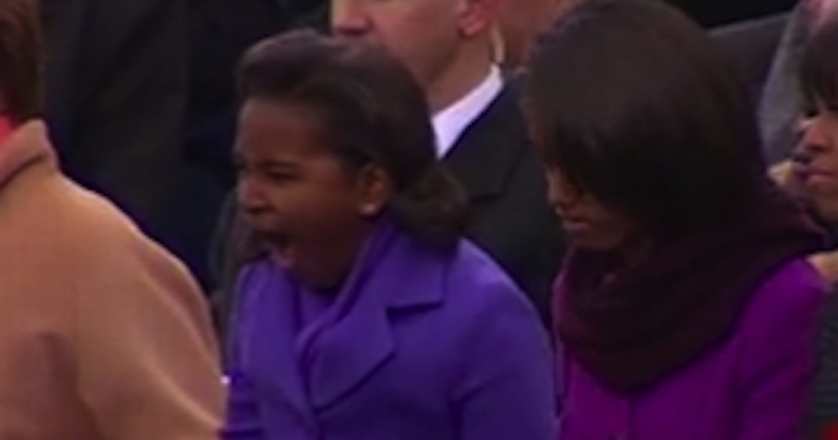 Sasha Obama lets a yawn escape during her father's inaugural speech.</p>