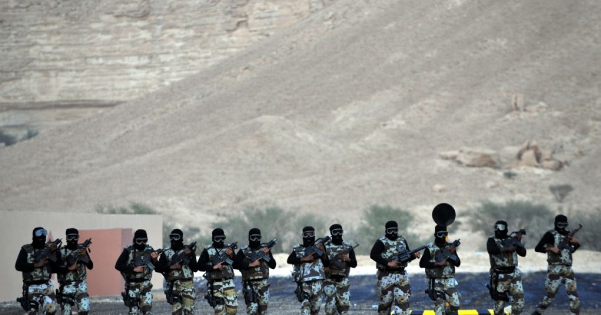 Saudi Arabia's special forces members of an anti-terror unit march during a display of their skills on March 22, 2011.</p>