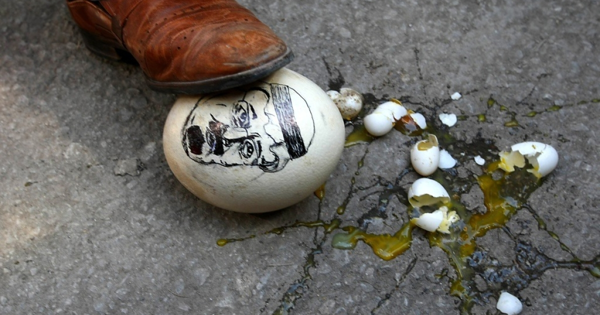 A demonstrator steps on an ostrich egg with a drawing of Saudi Arabia's King Abdullah on March 17, 2011 in front of the Saudi Arabia Embassy in Ankara as he attends a demonstration in support of mainly-Shiite demonstrators in Bahrain and denouncing the intervention by Saudi troops.</p>