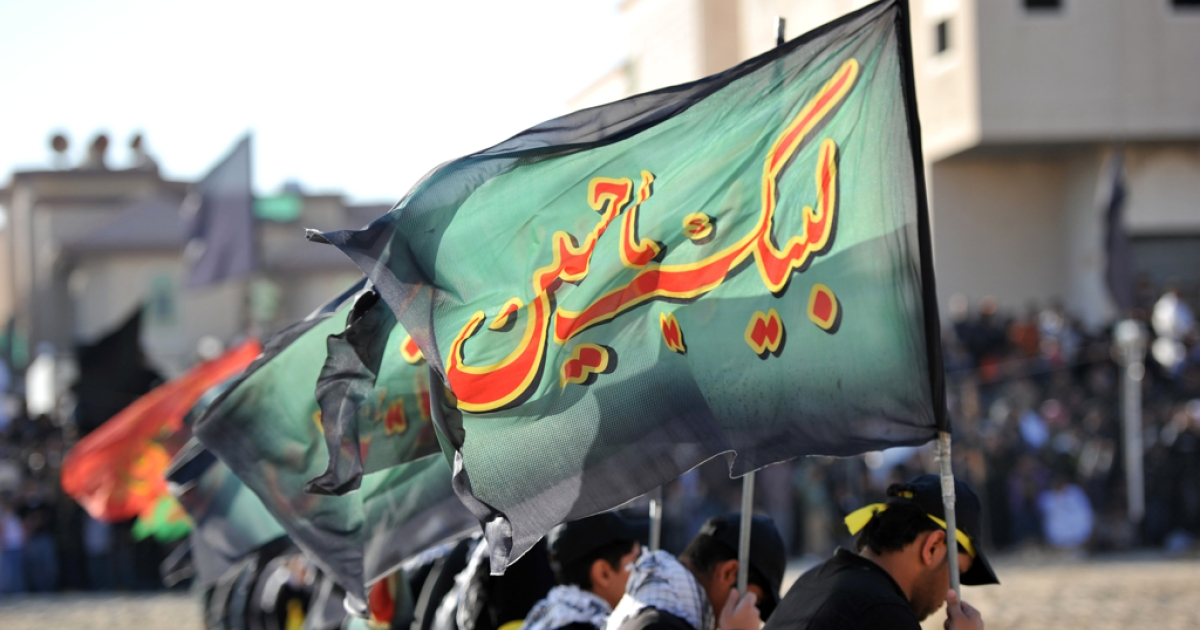 Saudi Shiite Muslim men take part in Ashura mourning rituals to commemorate the killing of Imam Hussein, grandson of Prophet Mohammed, in the mostly Shiite Qatif region of Eastern Province. Qatif has seen deadly protests against Saudi's Sunni rulers in recent months.</p>