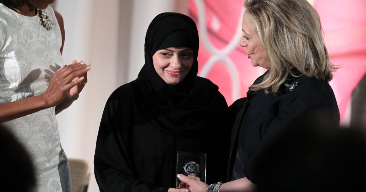 Saudi human rights lawyer Waleed Abu al-Khair is married to political activist Samar Badawi, shown here receiving an International Women of Courage Award awarded by U.S. Secretary of State Hillary Clinton (R) as first lady Michelle Obama looks on during a ceremony at the State Department March 8, 2012 in Washington, DC.</p>