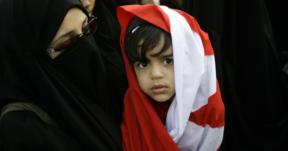 A Bahraini girl wrapped in her national flag takes part in an anti-regime rally at Pearl Square, the focal point of demonstrations in Manama, on March 1, 2011.</p>