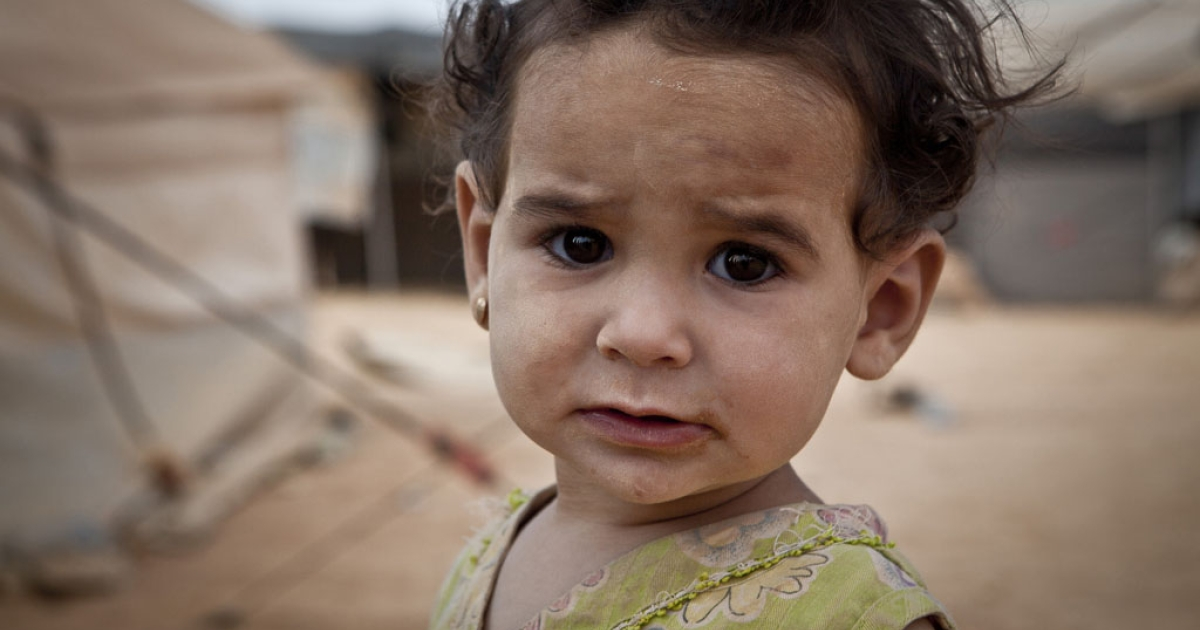 One-year-old Manal at Za'atari refugee camp, Jordan. She's one of thousands of children who have fled across Syria's border to escape an increasingly brutal conflict.</p>