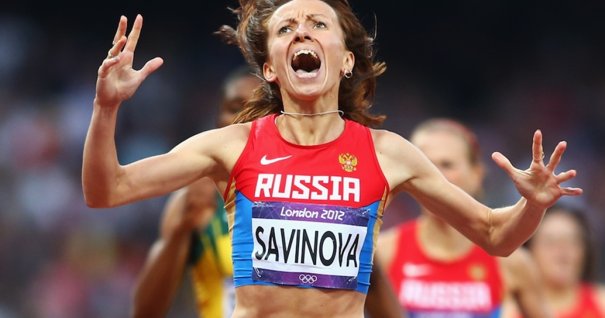 Mariya Savinova of Russia celebrates as she crosses the finish line to win gold in the Women's 800m Final on Day 15 of the London 2012 Olympic Games at Olympic Stadium on August 11, 2012 in London, England.</p>
